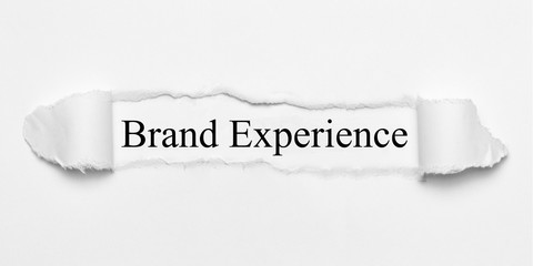 Brand Experience on white torn paper
