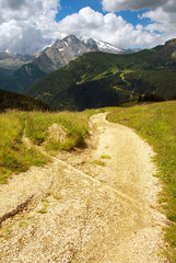 Way in Dolomites with Marmolada peak on the background, Italy