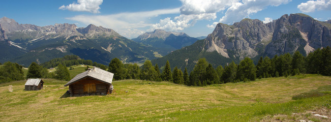 Woody cabin with Dolomites, Italy