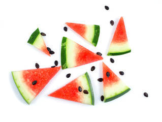 Watermelon pattern. Sliced watermelon with black seed on white background. Flat lay, top view.
