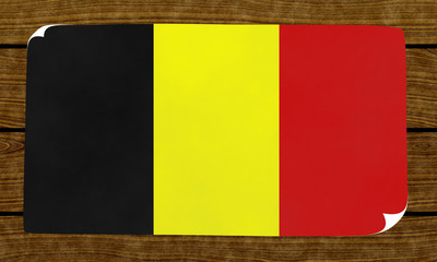 Illustration of an Belgian flag on the papier pasted on the woody wall