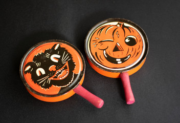 Two Orange and Black Antique Vintage Halloween Noisemaker Toys