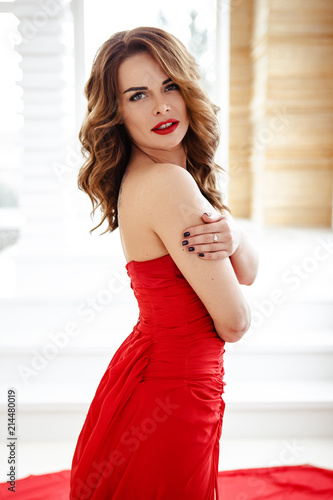 Beautiful Brunette Woman In A Red Dress Fashion Beauty Portrait