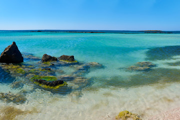 A magnificent panorama of the sea view with crystal clear water and dark rocks