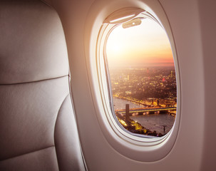 Airplane interior with window view of London city, Europe.