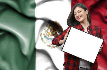Woman holding blank board against national flag of Mexico