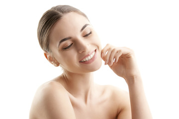 Young woman's face with radiant skin on isolated white background