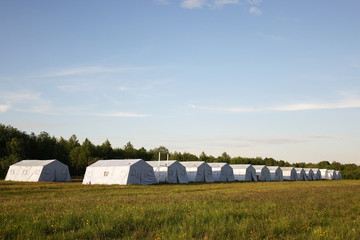 white large army tents. rescue camp.