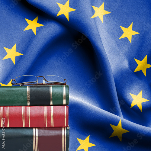 0e18c977f95a Education concept - Stack of books and reading glasses against National flag  of European Union