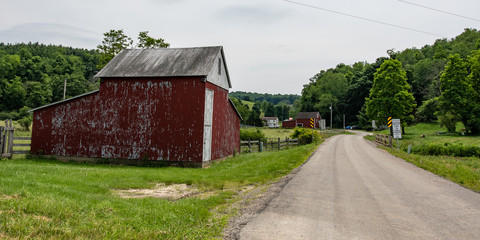 Old farm buildings on a country road