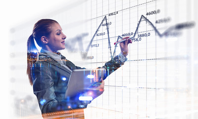 Business lady with tablet draw graphs