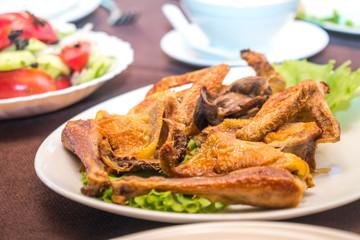 Roasted chicken on the plate, Chicken Tabaka, Georgian cuisine
