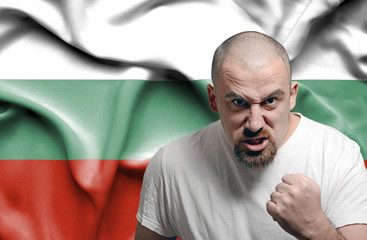 Angry man against flag of Bulgaria