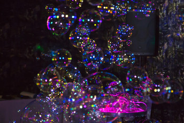 Many beautiful multi-colored bubbles. Festive show