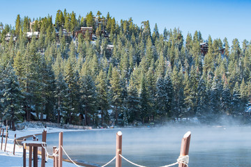 Cold misty lake shot with pine forest in the background shot in early morning at Lake Tahoe, NV, USA.