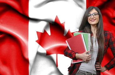 Recess Fitting Canada Happy female student holdimg books against national flag of Canada
