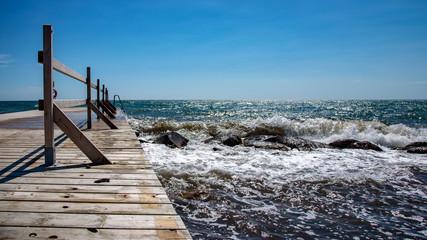 Seaside view. Wooden jetty, pier or sea bridge.