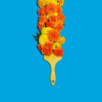 Flower brush on a blue background. Fashion minimal art.