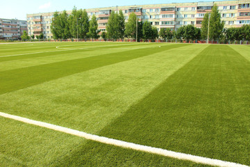 New artificial football field in the school stadium. Background.