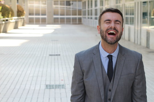 Businessman laughing really hard at work