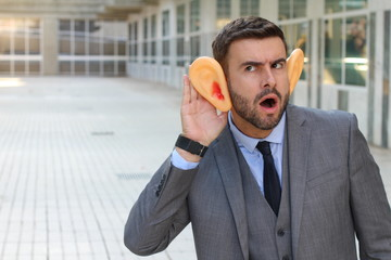 Funny big-eared businessman trying to hear something