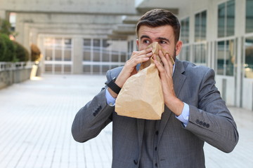 Man suffering an unpleasant smell at work