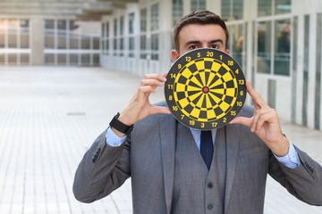 Businessman holding dartboard in office space