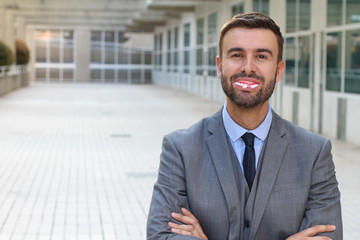 Businessman with fake dentures smiling