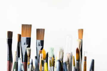 Used colorful creative brushes for painting arts with white background