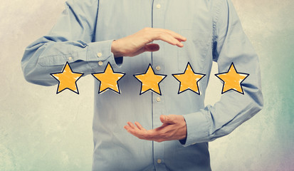 Five Star Rating with businessman on a soft colored wall