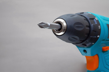 closeup of electric drill chuck on grey background