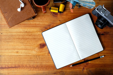 Open blank notebook on workspace of photographer desk.