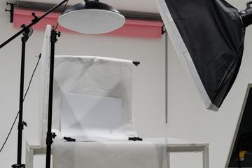 Product photo studio setup with lighting equipment