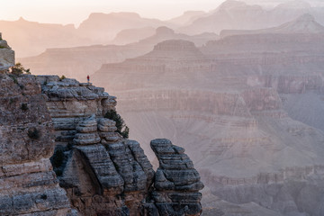 Man is Standing on the Cliff and Watching Sunset in Grand Canyon from Mather Point.