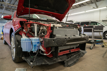 Wrecked car in repair shop