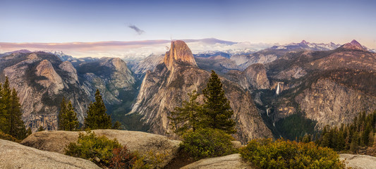 Panorama of Yosemite National Park from the Glacier Point Overlook in the evening.  The iconic Half Dome is warmed by the light of the late day sun