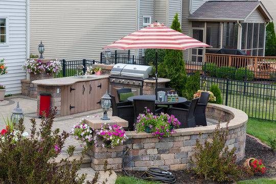 Upscale backyard round brick patio