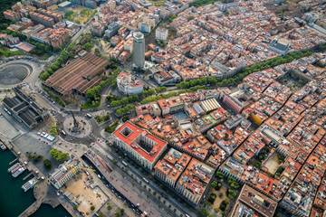 Aerial view of Barcelona Old Town and famous La Rambla boardwalk, Spain