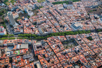 Old town of Barcelona with La Rambla street, Spain. Aerial helicopter view