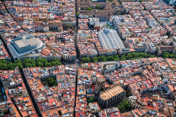 Aerial view of Barcelona Old Town narrow streets and famous La Rambla boardwalk, Spain