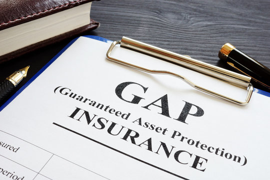 GAP insurance Guaranteed Asset Protection policy and pen.