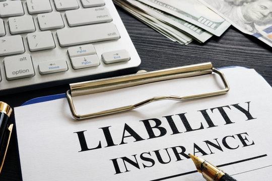 Liability insurance agreement on the desk.