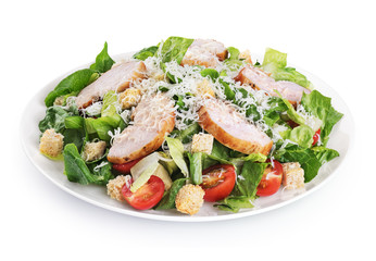Caesar salad with chicken fillet and parmesan cheese isolated on white background.