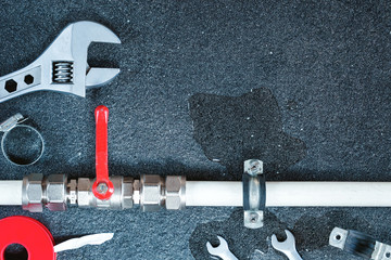 Plumber tools and equipment in a bathroom, plumbing repair service,repair concept.Top view.Copy space.