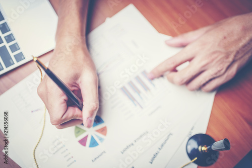 business hands pointing and signing terms and agreement papers