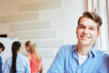 Young man smiling content