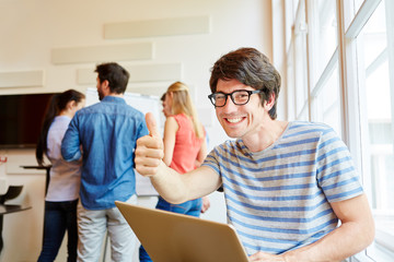 Nerd student holding thumbs up
