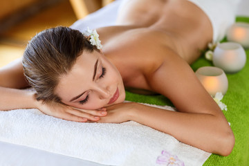 Young woman lying on massage table and waiting.