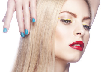 Close-up model girl face with bright make-up and nail polish manicure. Clean skin. White background