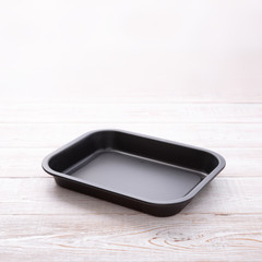 Empty baking tray for pizza close up on white wooden background top view square. Mock up for design